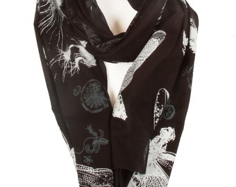 Striking cotton scarf with white dragonflies, moths and flowers on a black ground.