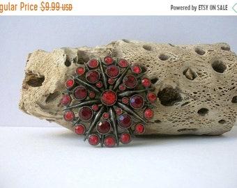 ON SALE Vintage Antiqued Metal Red Rhinestone Inlays Flower Burst Pin 42018