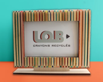 Large wooden photo frame made of recycled colored pencils