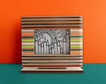 Wooden photo frame made of recycled colored pencils