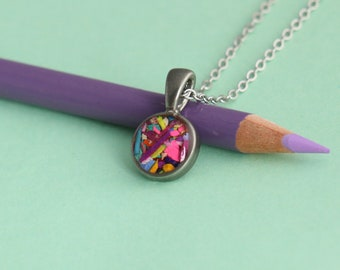 Colored pencils recycled into round pendant, pewter and resin