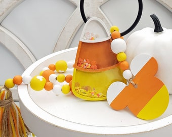"""Candy Corn Decor for Halloween Tiered Tray Bundle, Decorative Candy Corn Shaker & 26"""" Hand Painted Beaded Garland with Tassel and Mouse Head"""