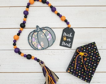 """Tabletop Halloween Decorations Bundle: 26"""" Trick or Treat Wooden Bead Garland, Standing House Sign & Confetti Filled 3D Black Pumpkin Shaker"""
