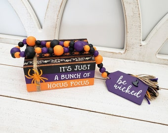"""It's Just A Bunch of Hocus Pocus Faux Book Stack & 26"""" Wooden Bead Garland w/ Be Wicked Tag for Small Tabletop Halloween Decorations Bundle"""