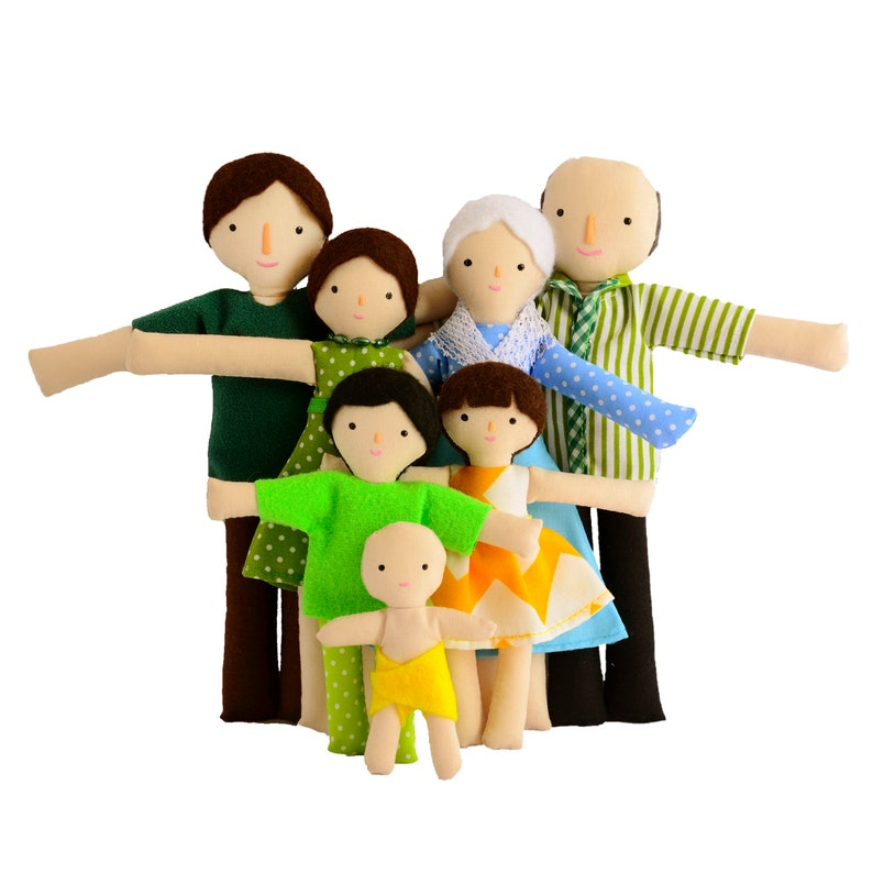 Family of seven dolls with light tan skin color image 0