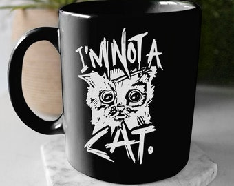 I'm not a cat mug - I'm not a cat meme - Cute white cat with graffiti font on a black ceramic mug based on the funny and famous meme!