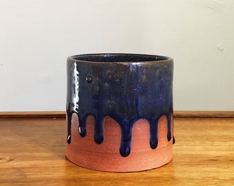red clay ceramic planter with blue drippy glaze