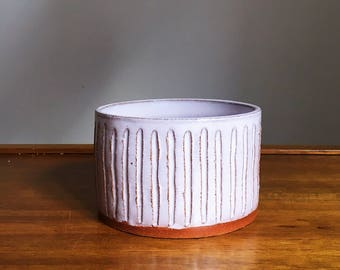 red clay ceramic planter with light pink glaze
