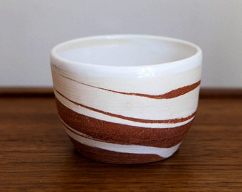 marbled white and red clay ceramic planter