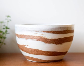 marbled white and red clay ceramic bowl