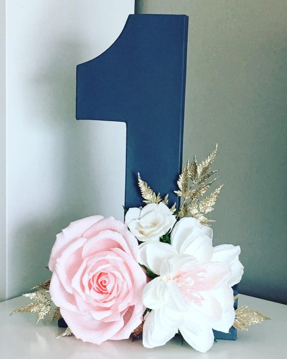 Birthday party numbers with paper flowers