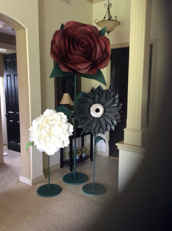 Giant paper flowers on stems! These beautiful paper flowers are custom pieces and can be made in any style and color.