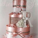Pink diaper cake centerpiece baby flower crown pregnancy announcement ideas mommy and me dress
