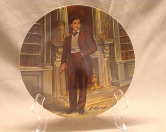 "Edwin M. Knowles Collectible Plate titled ""Rhett"" in the fourth issue in the Gone With The Wind Collection painted by Raymond Kursar - 1981"