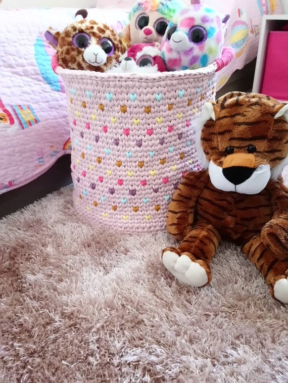 Large basket of multicolored crochet toy storage for baby or little girl