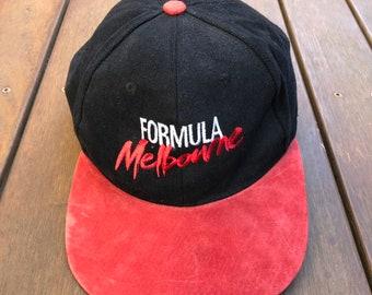 e5f1ff6b4a9c8 Vintage 90 s Melbourne Formula One Suede Brim Embroidered Souvenir Strap  Back Cap Retro Hip Hop Streetwear Australian F1 Car Racing Cap Hat