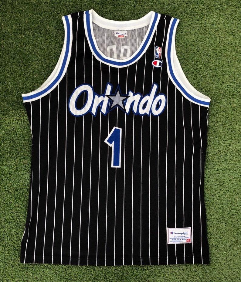 best website 649aa 22cb3 Vintage 90's NBA Champion Sportswear Orlando Magic Anfernee