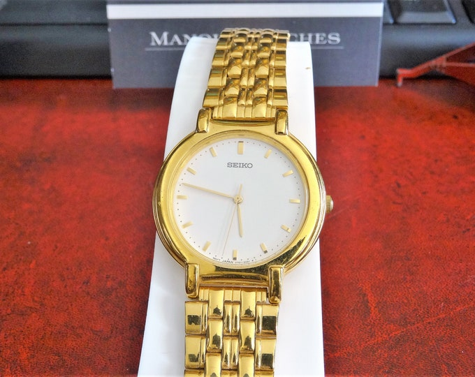 Seiko Gold Tone Water Resistant Men's Watch w/ 18mm Gold Tone Steel Band!