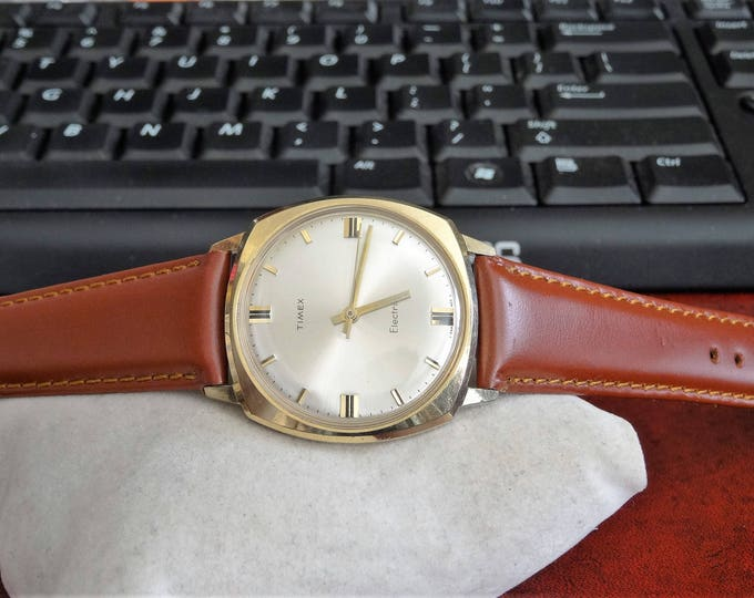 Vtg Timex Gold Tone Electric Crown-Less France Mens Watch w/ 19mm Leather Band