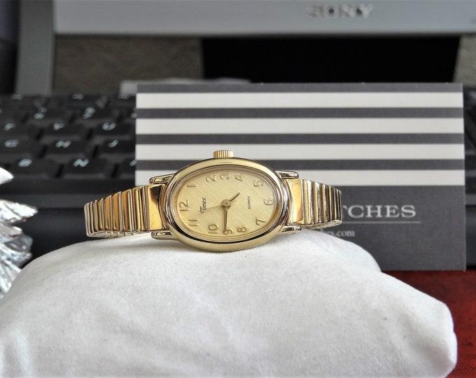 Vintage Timex Gold Tone Quartz Ladies Watch w/ 9mm Gold Tone Band & Timex Case!