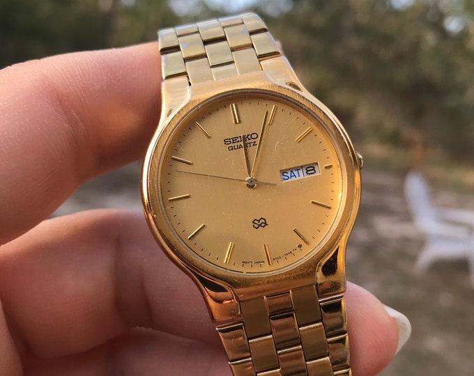 Retro 1990-2000 Seiko Gold Tone Day/Date W.R. Quartz Men's Watch w/ Gold Tone Band!