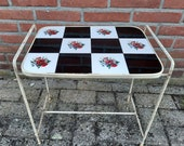 Vintage side table with rose tiles interspersed with black
