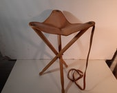 Vintage leather folding stool with strap