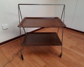 mid century design folding tea wagon serves trolley with two formica sheets with beautiful wood structure.