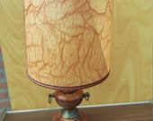 Vintage mahogany table-lamp with brass accents in antic-style
