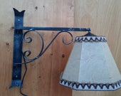 Vintage wrought iron reading lamp with pig bladder hood