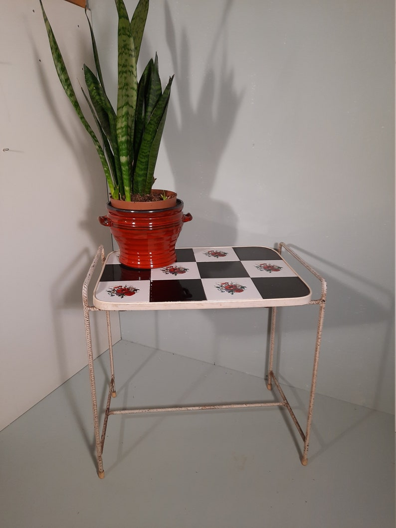 Vintage side table with rose tiles interspersed with black image 0