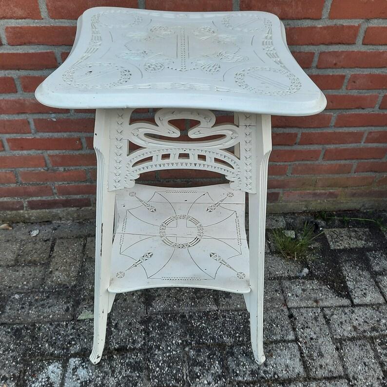 Antique oak plant table with frieze carving image 0