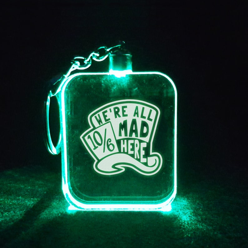 We're All Mad Here 7 Flashing RBG LED Lamp / Light Laser image 0