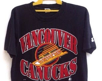 a378d438e Vintage 90s Vancouver Canucks T Shirt NHL Hockey Spell Out Starter Made In  Canada Medium Size