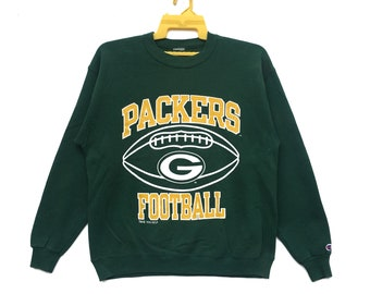 f7a2546318aa Vintage 90s Green Bay Packers Sweatshirt Spell Out Big Logo Green Colour  NFL Football Crewneck Champion Sweater Medium