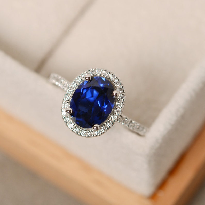 Halo engagement ring blue sapphire ring oval shaped image 1