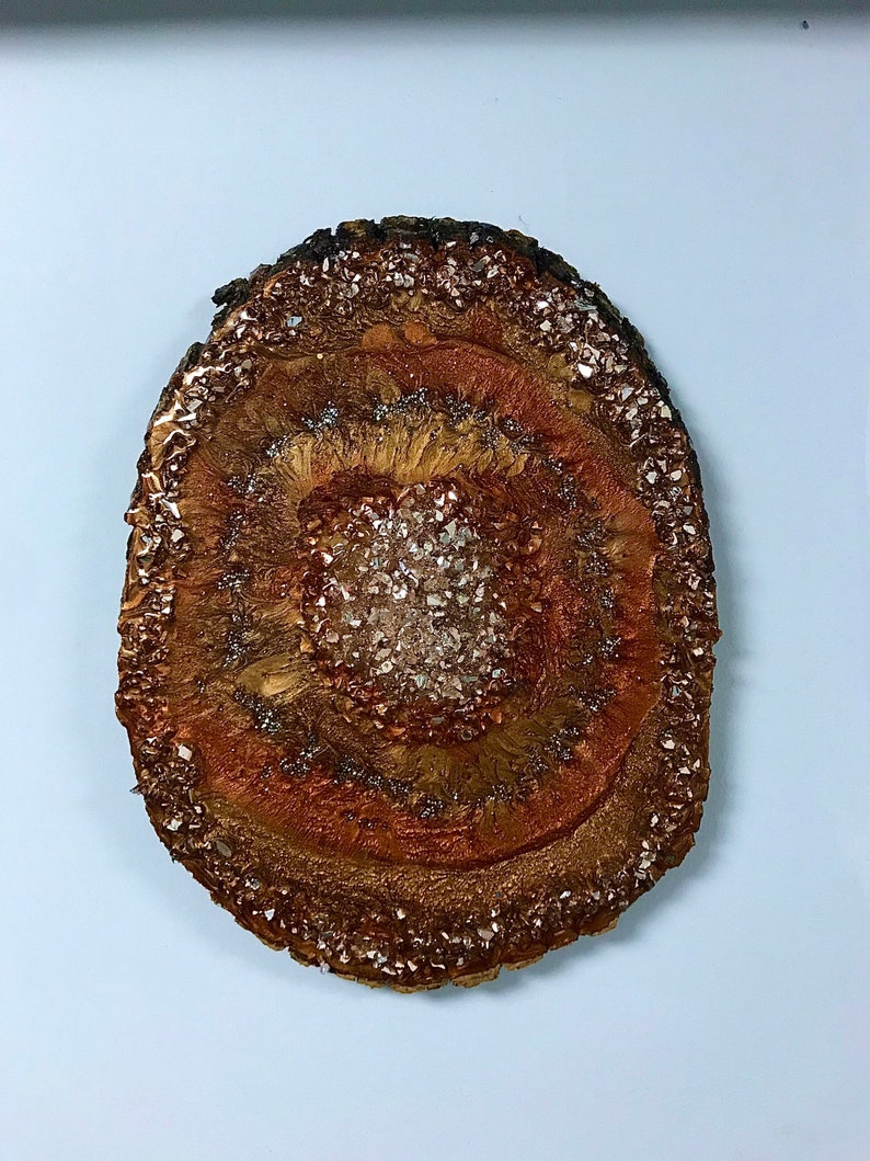 Tree ring glass crystal and diamond crystal resin pour on real wood slab.