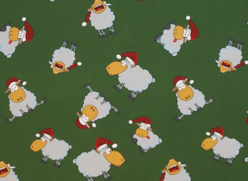 EUR 13.90/meter Cotton Jersey Christmas Sheep with Hat Green image 0