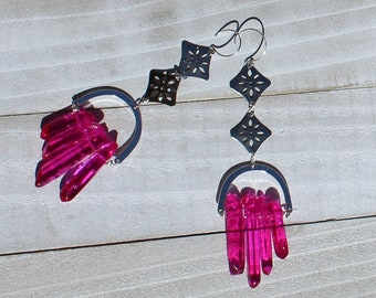 Silver flower medallion and hot pink aura quartz points suspended from silver u shaped findings and 925 sterling silver earwires