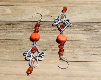 Bright orange magnesite stone coin bead with czech glass, suspended from silver chandelier and hung on silver 925 sterling silver earwires