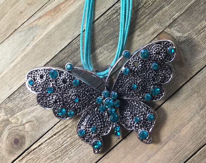 CLEARANCE! Chunky large statement big butterfly with embedded turquoise rhinestones in silver on teal multi-strand cord necklace