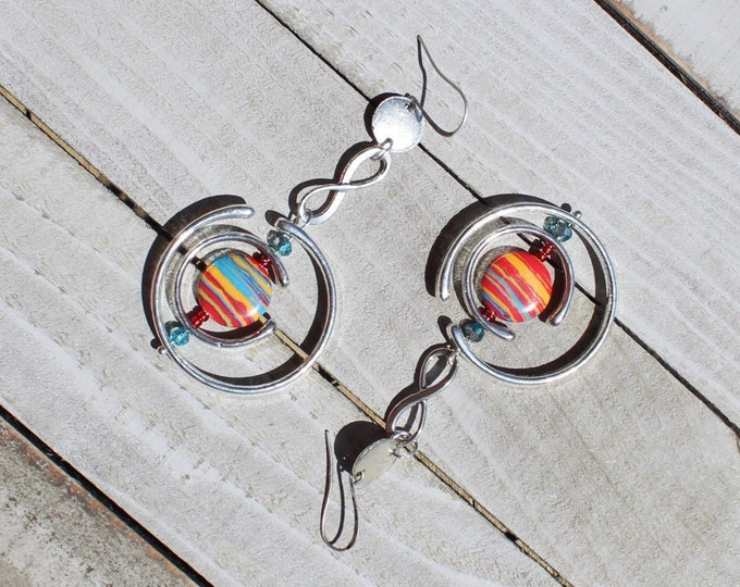 Coin matrix turquoise suspended inside silver circles with geometric shapes, on silver 925 sterling silver french hooks