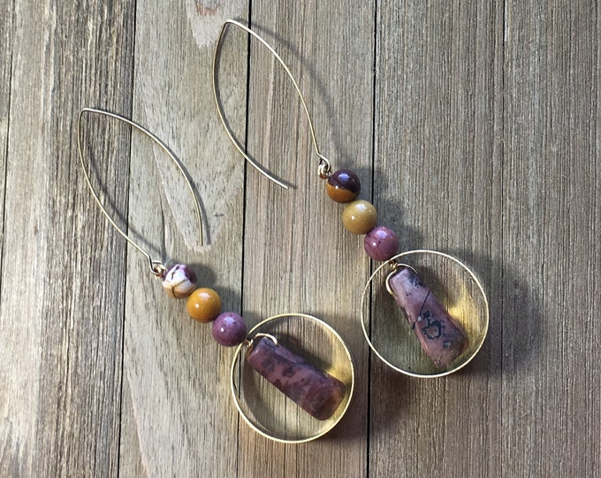 Chunky mookaite jasper tooth beads suspended in antique gold hoops on antique gold ear wires