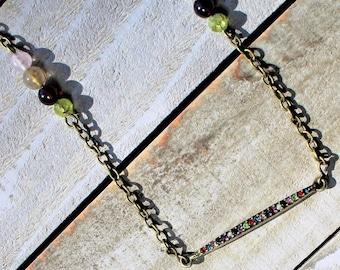 Rhinestone bar with garnet, peridot, rutilated quartz, strawberry quartz accents on gold chain