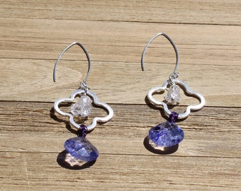 Brushed silver clover quatrefoil with herkimer diamond inside & dyed purple quartz at the bottom, hanging from 925 sterling silver earwires