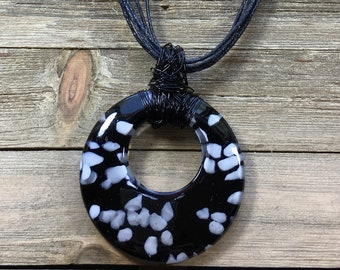 CLEARANCE! Black and white polka dot glass blown circle donut pendant with black hand wired bale on black hemp multicord  with extender