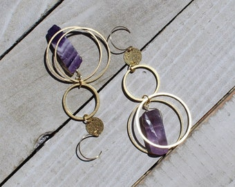 Amethyst dog tooth stones suspended inside and under brass circles, hanging from 14k gold filled ear wires