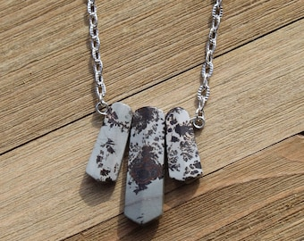 Apache artistic picture jasper graduated tooth beads suspended from silver chain, closes with an s hook