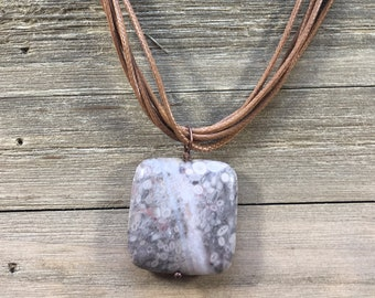 CLEARANCE! Marbled tree fossil jasper speckled square stone pendant in brown peach ivory on brown multi-cord necklace with extender