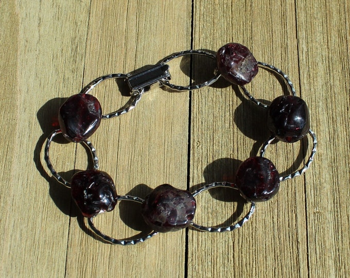 Rough genuine garnet stones with silver open oval links
